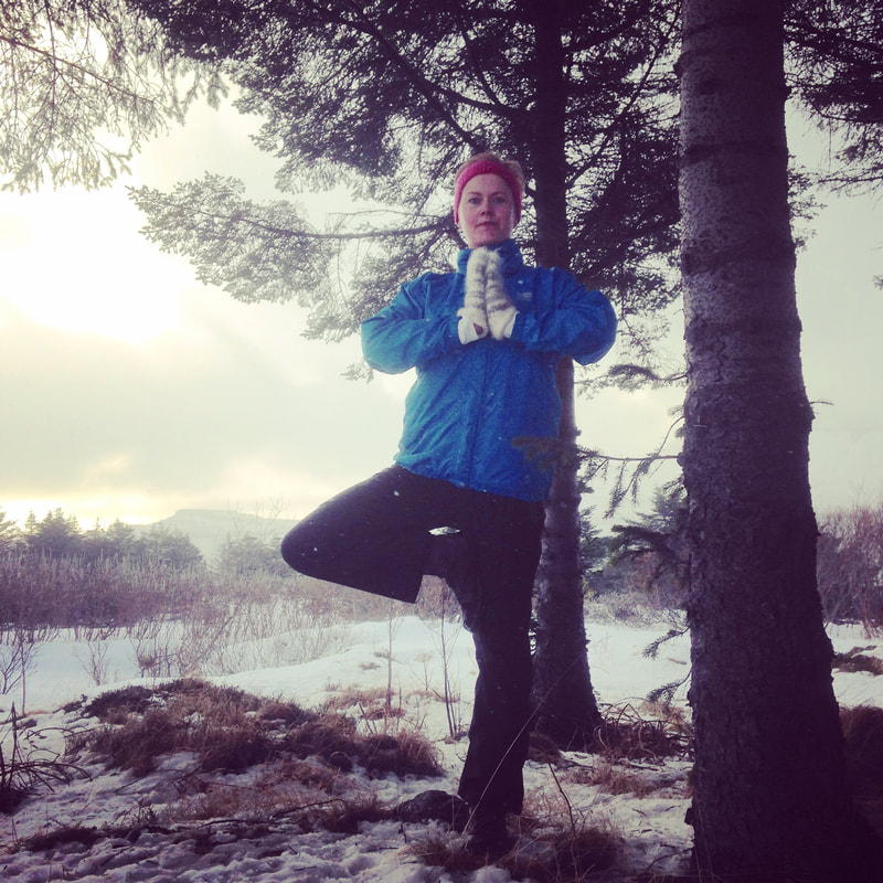 Our guide Solla preforming the Tree Pose.